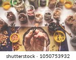 hand holding tweezers and a... | Shutterstock . vector #1050753932