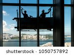 high rise window cleaning at... | Shutterstock . vector #1050757892