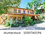view of historical old house is ...   Shutterstock . vector #1050760196