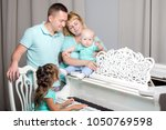 happy family with young... | Shutterstock . vector #1050769598