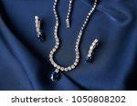 women's platinum necklace and... | Shutterstock . vector #1050808202