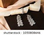 luxury earrings in jewel box....   Shutterstock . vector #1050808646