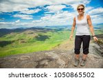 happy woman successfully hiking ... | Shutterstock . vector #1050865502