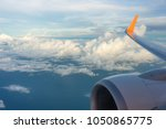 wing of an airplane flying...   Shutterstock . vector #1050865775