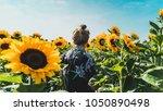 girl in sunflowers | Shutterstock . vector #1050890498