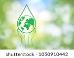 green world water in hand on... | Shutterstock .eps vector #1050910442