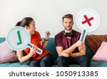 couple showing yes and no sign | Shutterstock . vector #1050913385