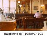drinking belgian beer point of... | Shutterstock . vector #1050914102