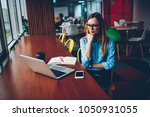 concentrated young woman in... | Shutterstock . vector #1050931055