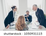 two stylish business persons in ... | Shutterstock . vector #1050931115