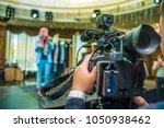 professional video camera.... | Shutterstock . vector #1050938462