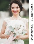 bride holding big and beautiful ... | Shutterstock . vector #1050943256