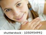 girl with braces | Shutterstock . vector #1050954992