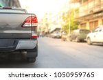 car on street blurry background.... | Shutterstock . vector #1050959765