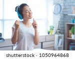 asian women are listening to... | Shutterstock . vector #1050964868