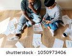 couple managing the debt   Shutterstock . vector #1050973406