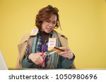 portrait of angry asian woman... | Shutterstock . vector #1050980696