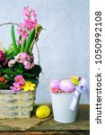 painted eggs  flowers. rustic... | Shutterstock . vector #1050992108