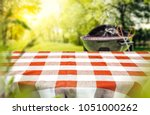 red and white tableclothe in... | Shutterstock . vector #1051000262