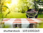 red and white tableclothe in... | Shutterstock . vector #1051000265