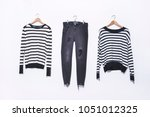 two striped shirt with jeans on ... | Shutterstock . vector #1051012325