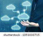 businessman holding cloud...   Shutterstock . vector #1051033715