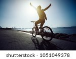 hands free cycling cyclist... | Shutterstock . vector #1051049378