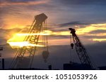 silhouette construction tower... | Shutterstock . vector #1051053926