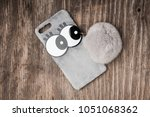 cell phone case with big eyes... | Shutterstock . vector #1051068362