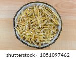 dried anchovy in ceramic bowl.... | Shutterstock . vector #1051097462