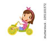 lovely little girl riding... | Shutterstock .eps vector #1051101572