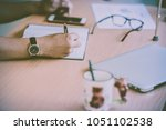 close up of hand taking notes... | Shutterstock . vector #1051102538
