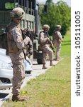 soldiers in full gear patrol | Shutterstock . vector #105111005