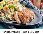 healthy caesar salad with... | Shutterstock . vector #1051119185