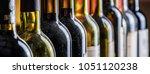 line of wine bottles. close up.