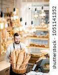 handsome bread seller with... | Shutterstock . vector #1051141352