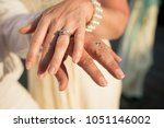 a happy bride and groom show... | Shutterstock . vector #1051146002