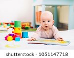 adorable 6 months old baby... | Shutterstock . vector #1051147718