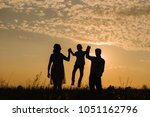 family on sunset background.... | Shutterstock . vector #1051162796