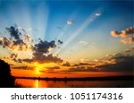 sunset sky clouds over river... | Shutterstock . vector #1051174316