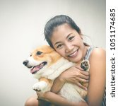 portrait of asia woman with dog ... | Shutterstock . vector #1051174685