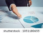 business man point a document... | Shutterstock . vector #1051180655