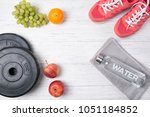 fitness concept  pink sneakers  ... | Shutterstock . vector #1051184852