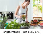 smiling vegan woman making a... | Shutterstock . vector #1051189178