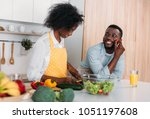 smiling african american couple ... | Shutterstock . vector #1051197608