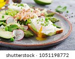 healthy breakfast. eggs poached ... | Shutterstock . vector #1051198772