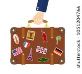 vintage old travel suitcase in... | Shutterstock .eps vector #1051204766