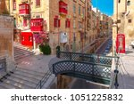 the traditional maltese street... | Shutterstock . vector #1051225832