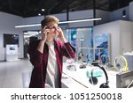 a handsome young man testing... | Shutterstock . vector #1051250018