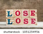 Small photo of Letter block in word lose lose on wood background